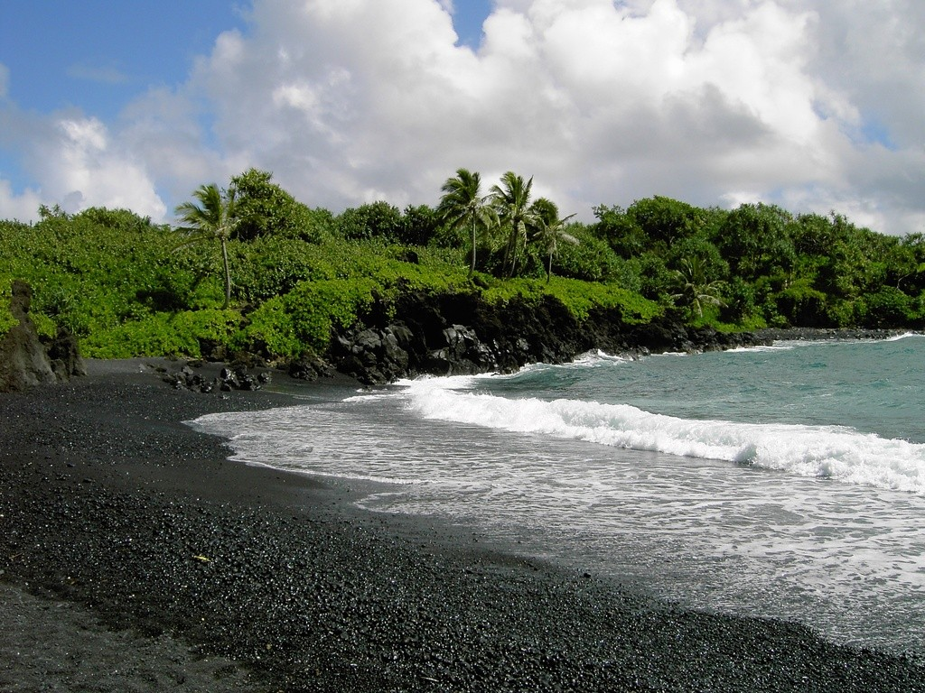 You'll find the deep, dark, jet-black sand of your dreams at Waianapanapa.